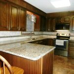 Crema Pearl Granite With Dark Cabinets
