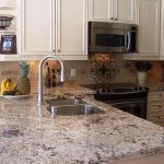 Crema Pearl Granite With White Cabinets